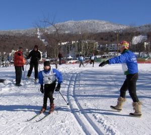 Parents directing racer into the transtion zone to change skis from Classic to Freestyle.